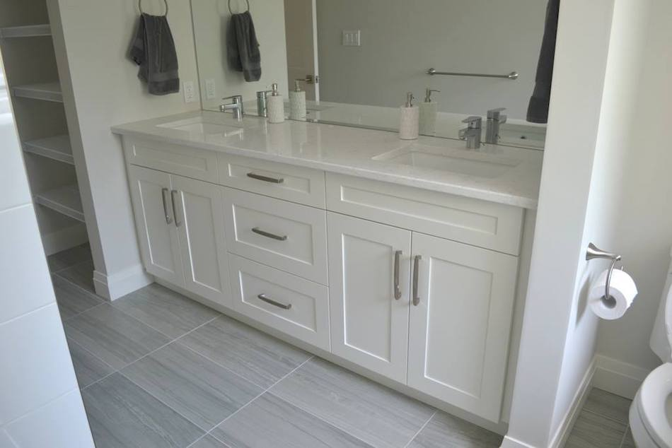 This soft white bathroom vanity paired with marbled Quartz top provides a sense of serenity. Adding brushed chrome hardware soothes this neutral colour ... & Bathroom Vanities - Verbeek
